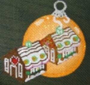 Gingerbread House Reflecting in Orange Ornament
